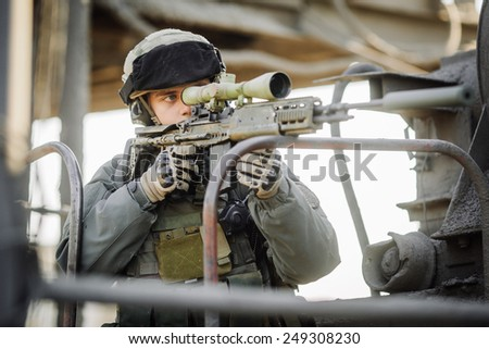 military soldier shooting an assault rifle - stock photo