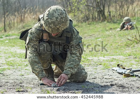 Military soldiers at tactical exercises with mine - stock photo