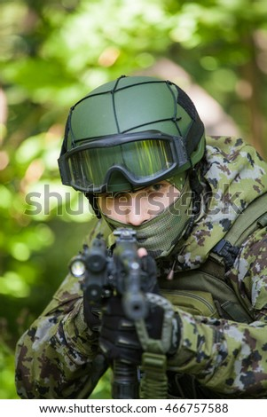 Military soldiers in the forest. Being at gunpoint