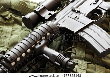 Military still life. AR-15 carbine (The Black Rifle) and tactical vest - stock photo