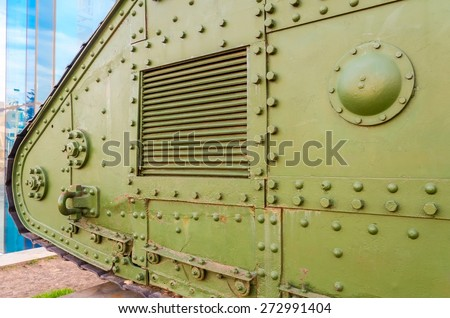 Military tank details. Old war tank with bolts - stock photo