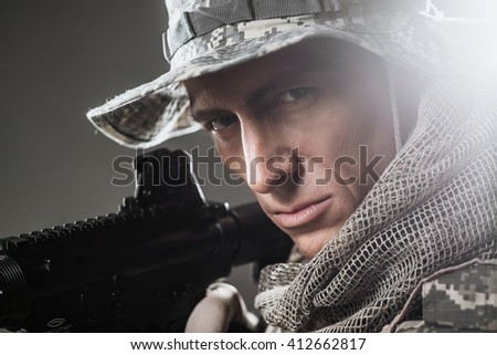 Military, war, conflict, soldiers - Special forces soldier man hold Machine gun on a  dark background. Soldier takes aim.