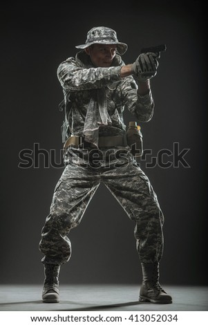 Military, war, conflict, soldiers - Special forces soldier man hold Machine gun on a  dark background. Military equipment NATO soldiers