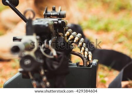 military weapon machine gun with ammunition closeup - stock photo