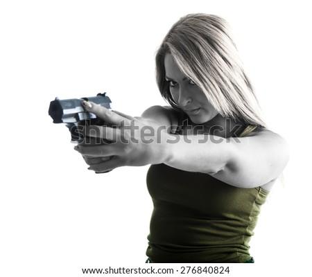 Military woman aiming a gun - stock photo