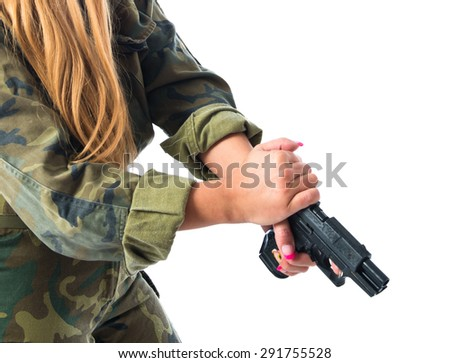 Military woman carrying a gun - stock photo
