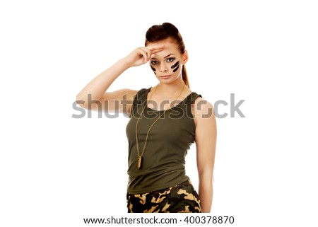 Military woman making salute gesture