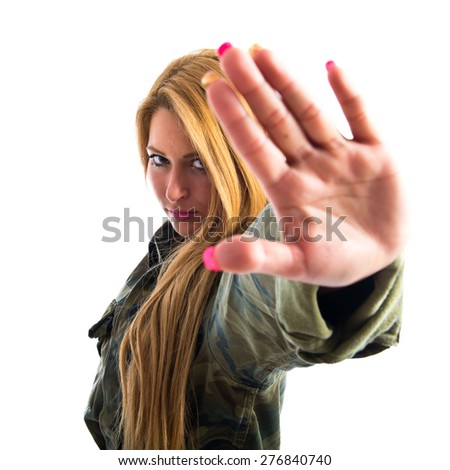 Military woman making stop sign  - stock photo