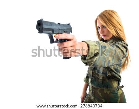 military woman shooting a gun - stock photo