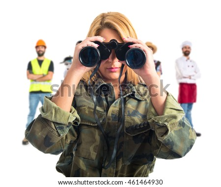 Military woman with binoculars with many people behind