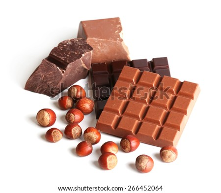 Milk and black chocolate bars with hazelnuts isolated on white - stock photo