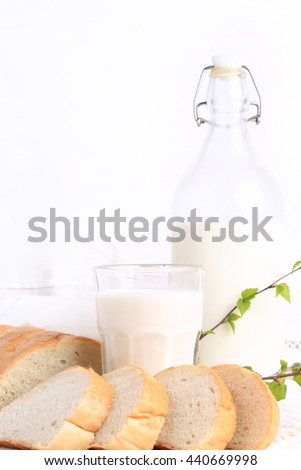 milk and bread on a white lace background bio organic product fresh pastries healthy lifestyle