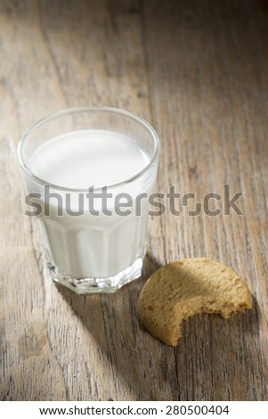 Milk and Cookies on a rustic wooden table.