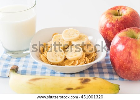 milk, apple, banana and cornflakes for breakfast