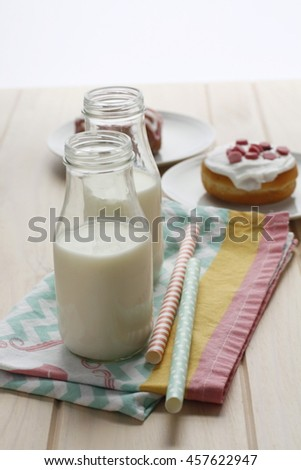 Milk bottle and a doughnut