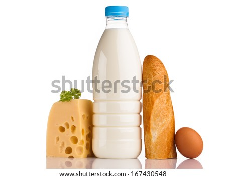 milk bottle cheese and egg isolated on white  - stock photo