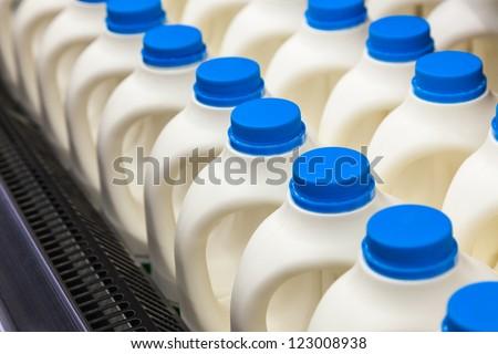milk bottle in a row in the market - stock photo