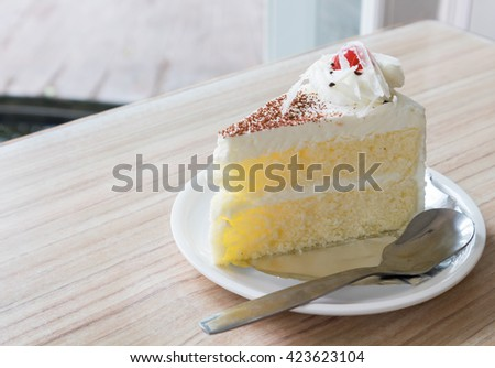 Milk cake delicious on the wood table - stock photo