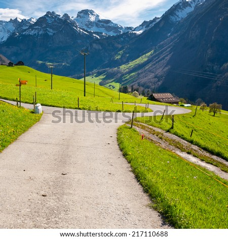 Milk Cans at the Crossroads High Up in the Swiss Alps - stock photo