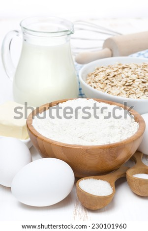 milk, cereal and ingredients for baking, close-up, vertical - stock photo