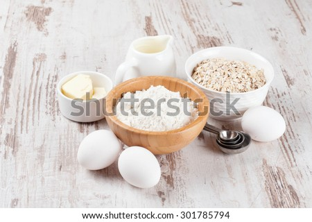 milk, cereal and ingredients for baking, horizontal - stock photo