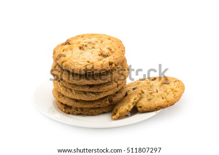 Milk chocolate almond cookies in white dish on white background