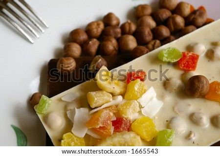 Milk chocolate bar and nuts - stock photo