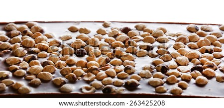 Milk chocolate bar with hazelnuts isolated on white - stock photo