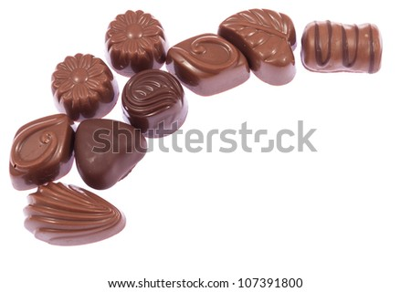 Milk chocolate candies isolated on white background - stock photo
