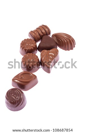 Milk chocolate confectionery candies isolated on white background - stock photo