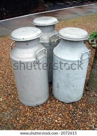 Milk Churns at a Country Railway Station
