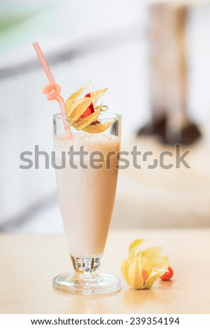 Milk cocktail decorated with physalis - stock photo
