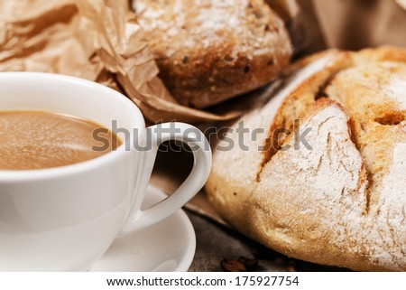 Milk coffee and homemade piece of bread