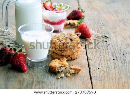 milk, cookies and strawberries  - stock photo