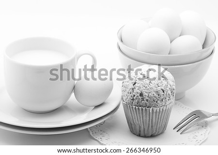 Milk  cup cake and eggs on a white background.