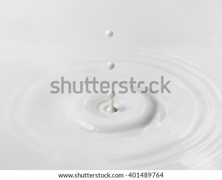 milk drop or white liquid drop created ripple wave - stock photo