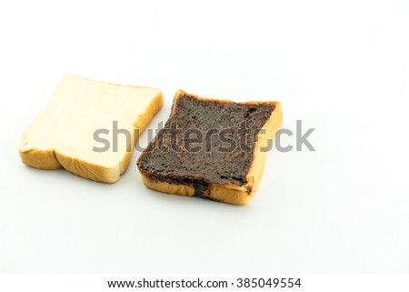 milk flavored cream spread bread slices and Sliced chocolate bread isolate on white - copy space  - stock photo