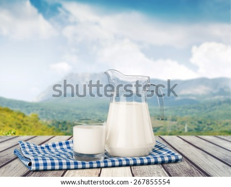 Milk, glass, tablecloth. - stock photo