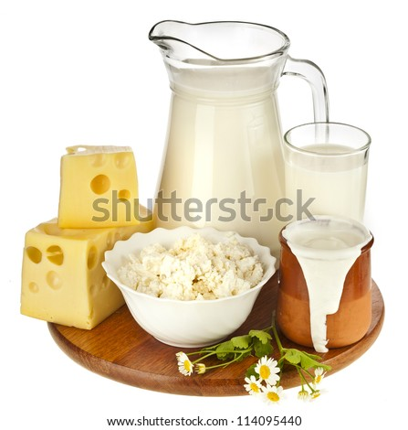 Milk in a glass on the wooden board isolated on white background - stock photo