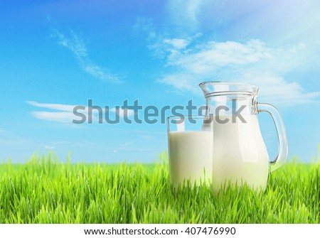 Milk in glassware on nature background - stock photo
