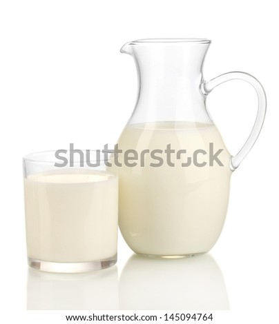 Milk in jug and glass isolated on white - stock photo