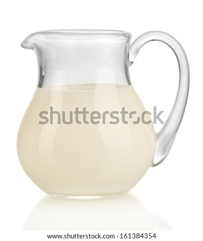 Milk in jug isolated on white - stock photo