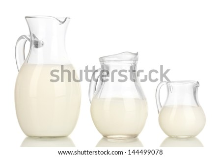 Milk in jugs isolated on white - stock photo