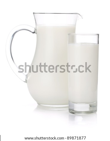 Milk jug and glass. Isolated on white background - stock photo