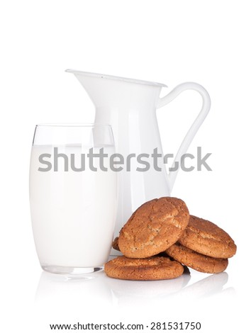 Milk jug, glass and cookies. Isolated on white background - stock photo