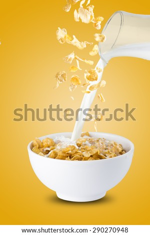 Milk Pour Into Bowl of Cereal Corn Flakes - stock photo