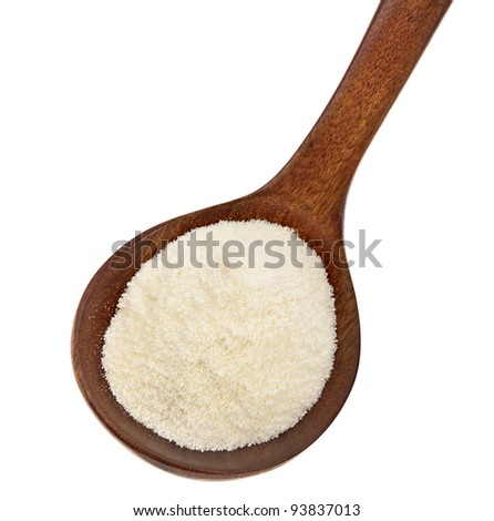 milk powder drink  in a wooden spoon  Isolated on white background - stock photo