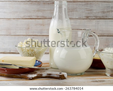 Milk products on a white wooden table. Selective focus - stock photo