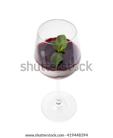 Milk rice pudding with raspberry cream. Served in wine glass with fresh mint. Isolated on a white background. - stock photo