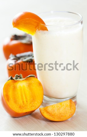 Milk shake with fruit -  kaki. - stock photo